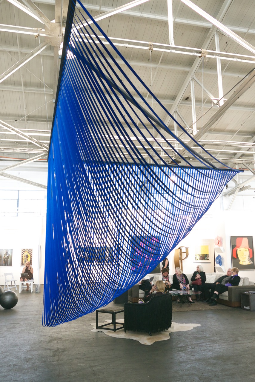"""Sabine Reckewell, """"Float,"""" 2016, nylon webbing, nails, wood strips, 138 x 270 x 192 inches approx (11 ½ x 22 ½ x 16 feet approx)"""