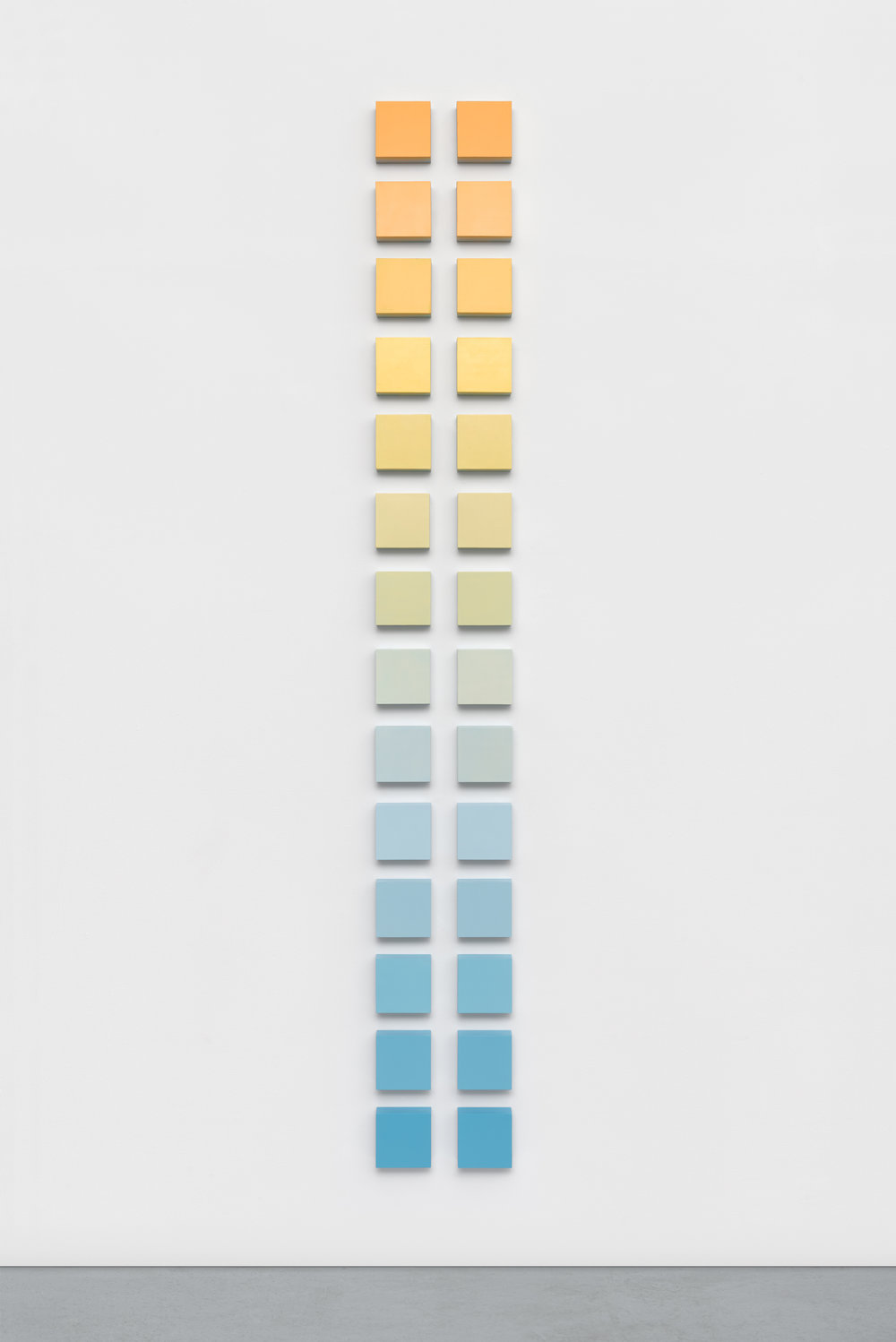 """Marigold Ladder,"" 2016, phosphorescent and acrylic on panel, (28) 5 x 5 x 2 inch panels, 96 x 12 x 2 inches overall"