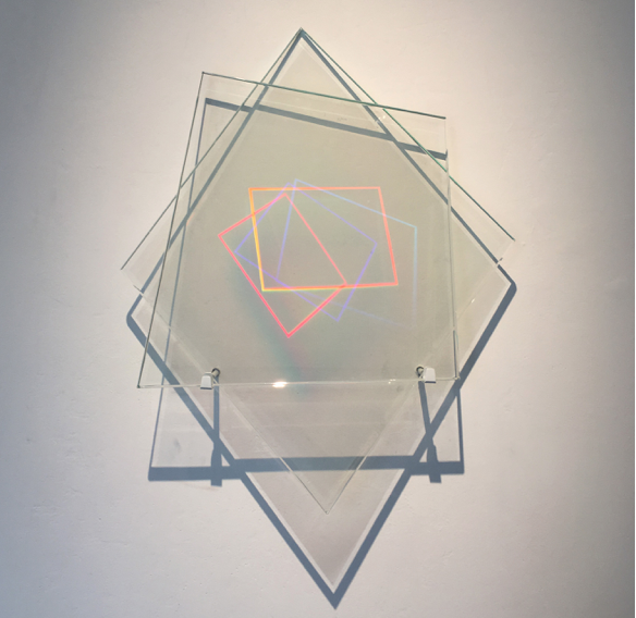 """Polymorth #5,"" 2017, holograms laminated in glass, steel wall mount, 24 x 22 x 6 inches, optical depth volume 11 inches"