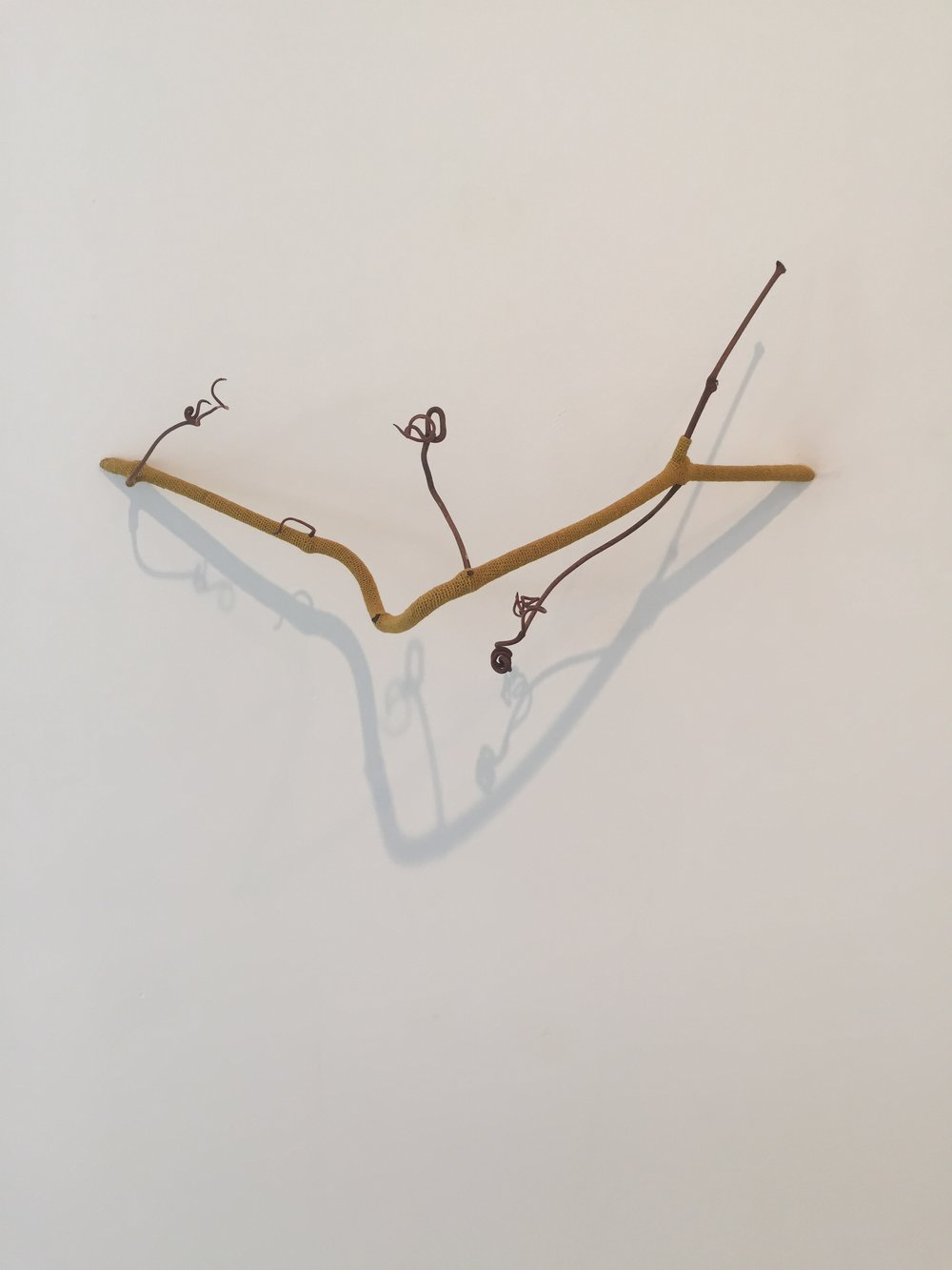 """Esther Traugot, """"Perch,"""" 2016, grape vine segment, and hand dyed cotton and yarn, 6 x 15 x 4.5 inches"""