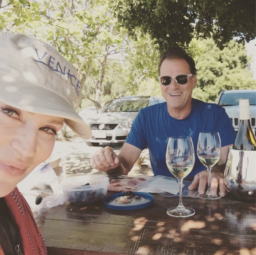 Wine tasting with her hubby.