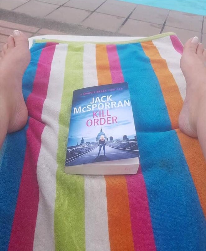 Joanne, reading Kill Order in Morgan, Spain.