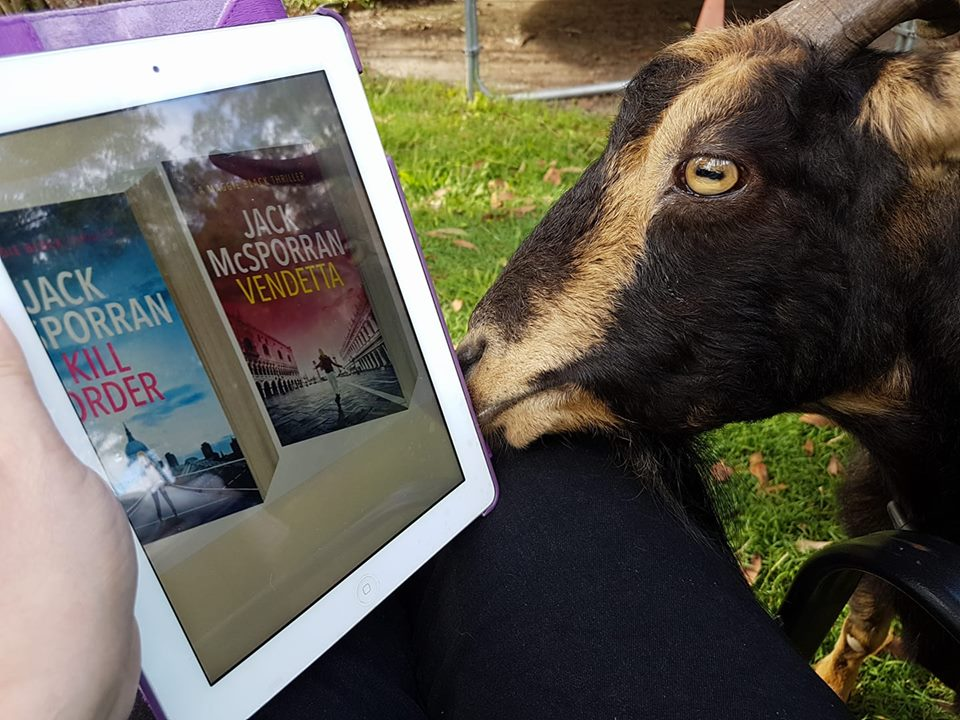 Tonja reading with her goat, Dambo, all the way in Australia. =)