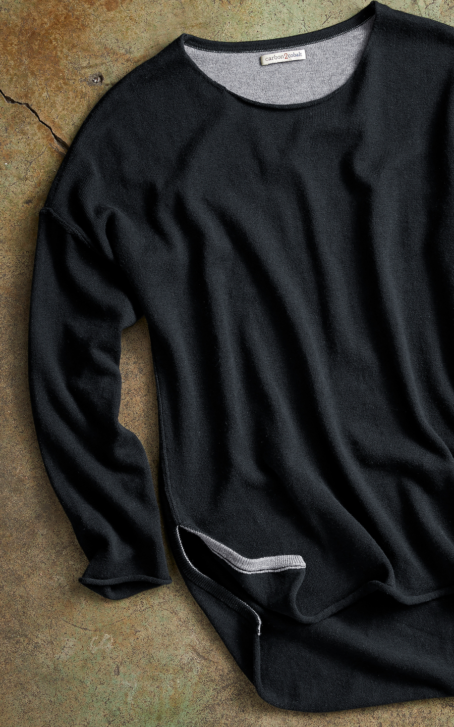 Meet the   Eclipse Sweater .  We think a black sweater is a great element to always have — especially when it's made from a cotton/cashmere blend that is refined but also ridiculously comfy.