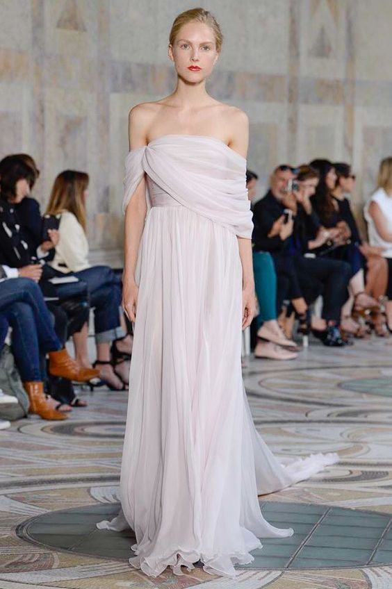 Wedding dresses with Grecian draped sleeves featured on LOVE FIND CO.