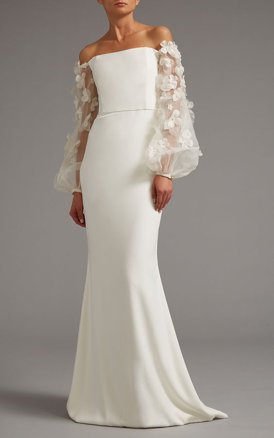 Wedding dress with voluminous sleeves featured on LOVE FIND CO.