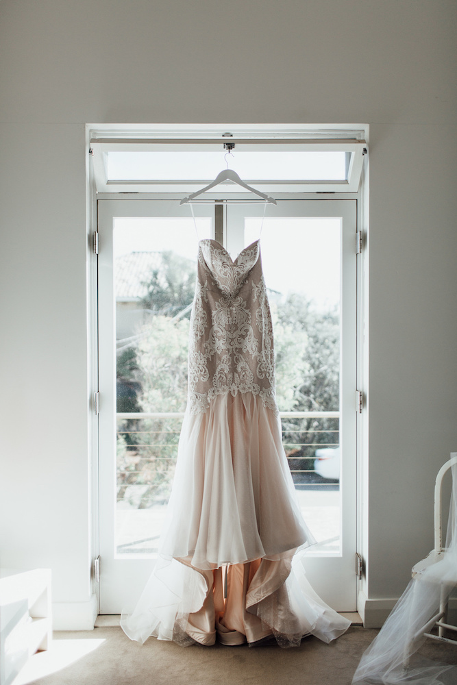 Ashleigh & Adrian | Ashleigh wears a Wildflower by Malachi Empire wedding dress featured on LOVE FIND CO.