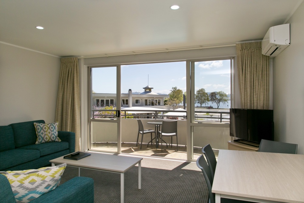 One bedroom with views of pool area and lake taupo