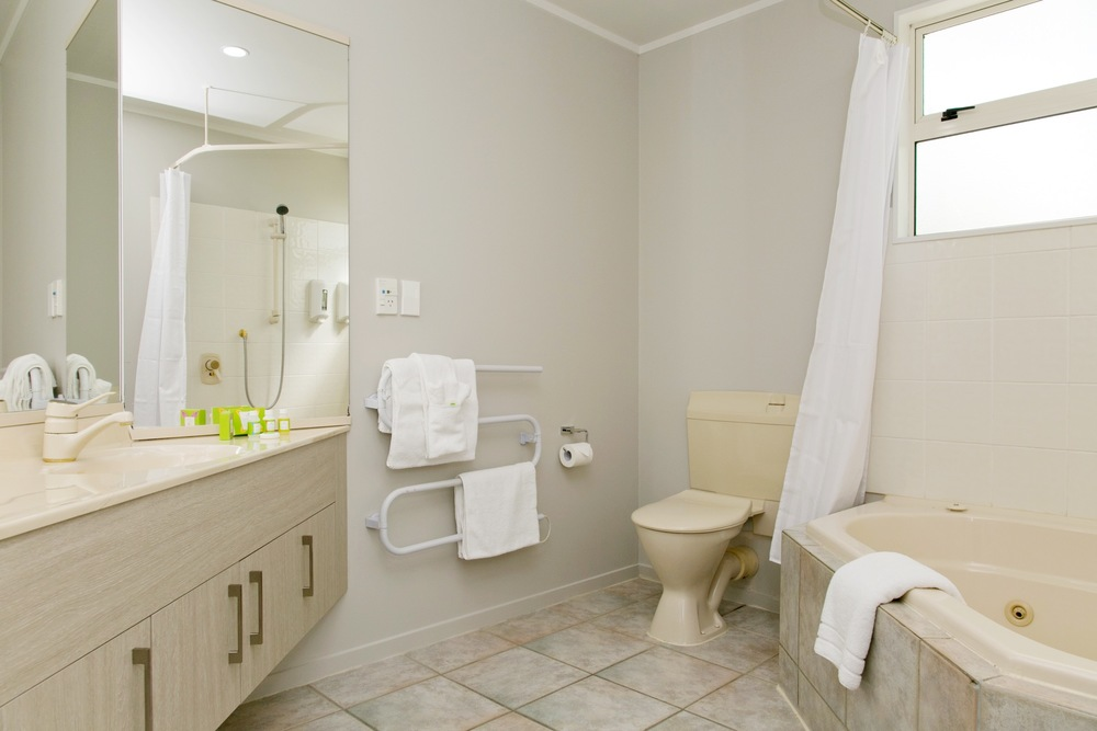 three bedroom bathroom with spa bath.jpg