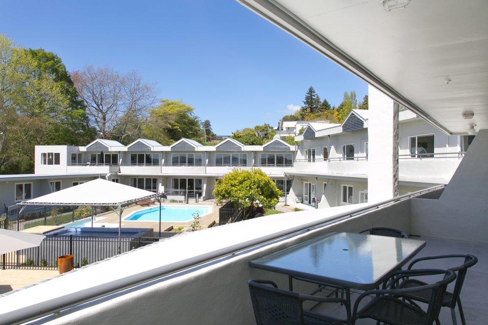 deluxe one bedroom balcony overlooking pool 1-min.jpg