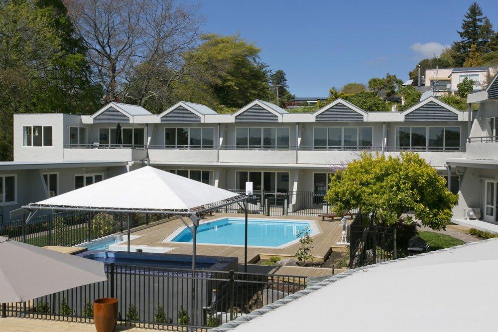 deluxe one bedroom balcony overlooking pool 2-min.jpg