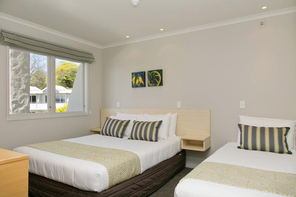 deluxe one bedroom bedroom-min.jpg