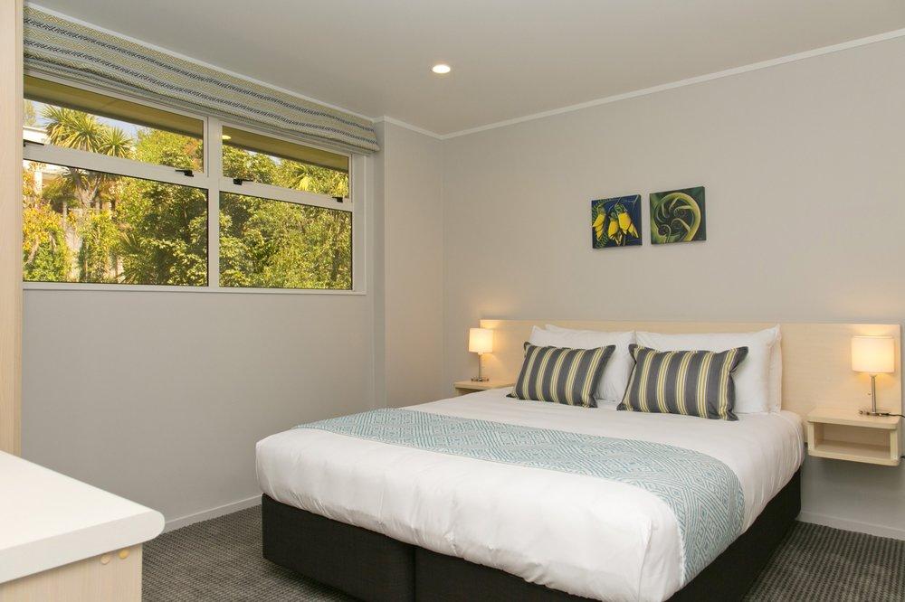 one bedroom lake view bedroom-min.jpg