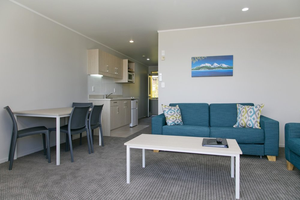 one bedroom lake view kitchenette and living area 1-min.jpg