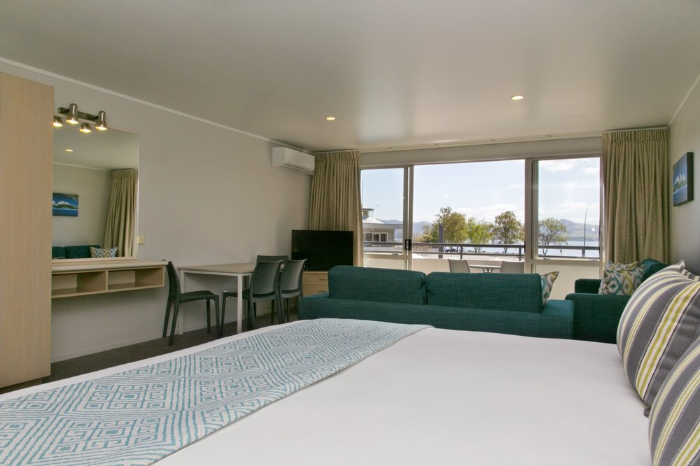 spa studio with lake view bed and living area-min.jpg