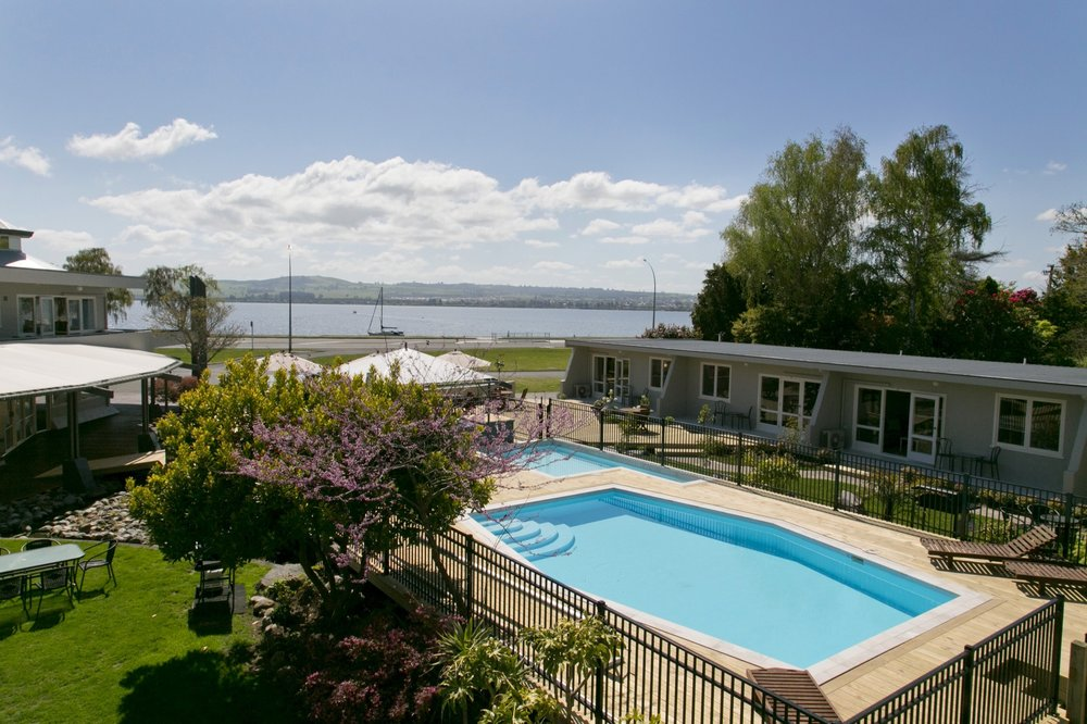 two bedroom lake view view form balcony over pool area-min.jpg