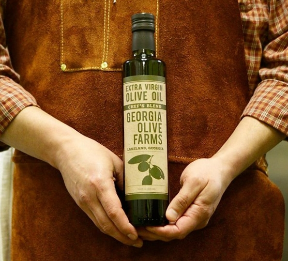 "Georgia Olive Farms olive oil is a premium, locally harvested olive oil sold exclusively in Dothan at KBC. The flavor is described by Esquire magazine as ""smooth and ticks the back of your throat with a faint peppery kick, the way it should."""