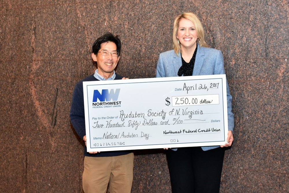 ASNV President Carl Kikuchi Accepting Donation From NWFCU's Michelle Sandy