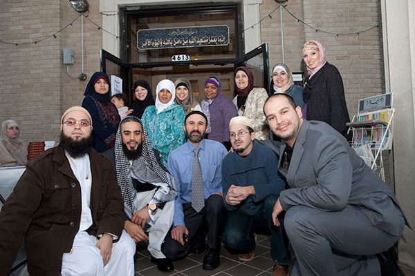 Members of the Center, a Sunni Mosque, gather on Hispanic Muslim Day at the entrance to the building. Photo by Christopher Lane.