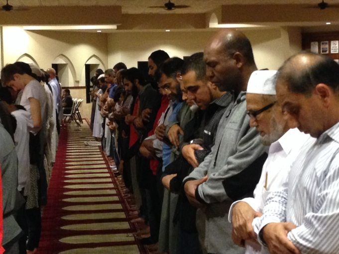 Evening prayers at the Maryam Mosque in Sugar Land Texas. Jaime Mujahid Fletcher is fourth from the right. Credit: Jason Margolis