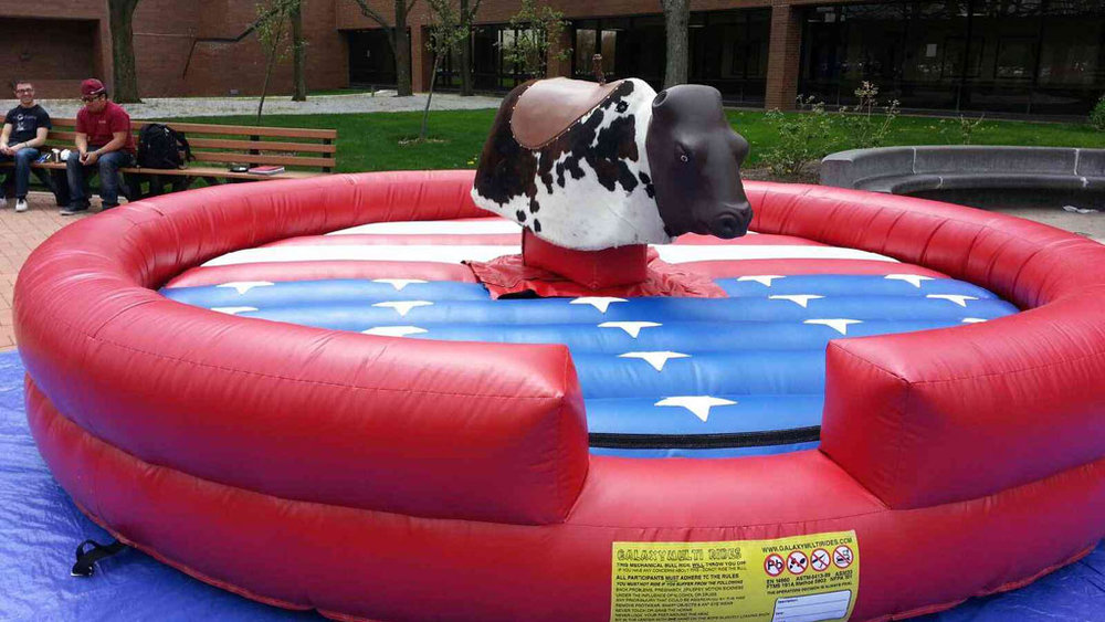 Bull Ride - How much would you pay to see your dad, your mom or your siblings ride a mechanical bull (and fall off of it)? With an inflatable base and a trained operator, it's all the fun that you imagine