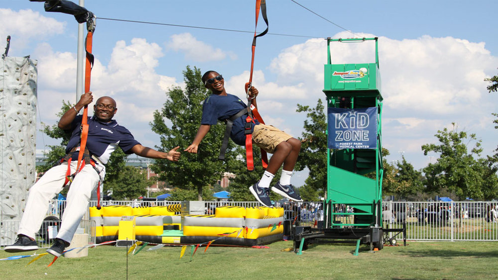 100ft ZipLine - This 100-foot zipline is one of the most anticipated rides in our carnival. Zip through the GRB & enjoy the thrill. Don't forget to wear appropriate clothing to take full advantage of this ride