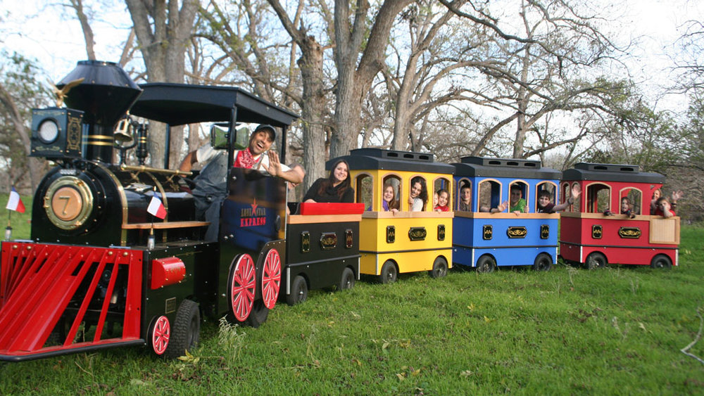 Circus Train - The Circus Train is a circus themed train ride that features various circus animals, clowns, and characters. This is one of those rides every child loves to ride with their parents and siblings.