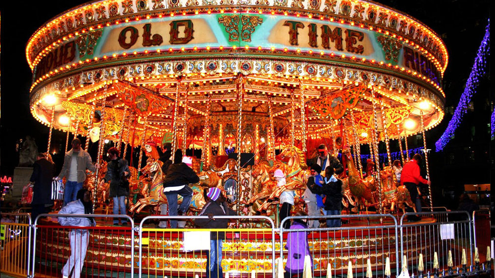 Carousel - Every child loves to ride the carousel horses. The carousel horse of this ride is a size that is rideable by children and/or average-sized adults. This ride is fun and is picture perfect for your family.