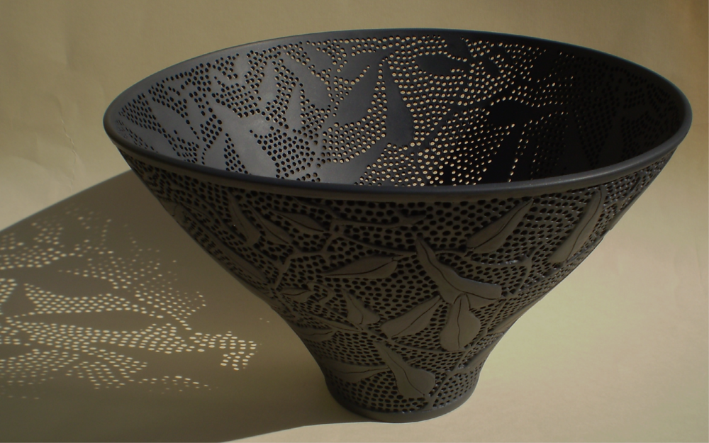 Sandra Black    Hardenbergia  Slip cast, carved and piercedSeeleys Ebonyporcelain 15.3cms  x 26 cms Photographer: Sandra Black