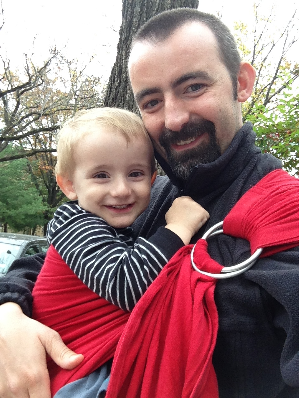 The husband rockin a ring sling! Bright red no less...