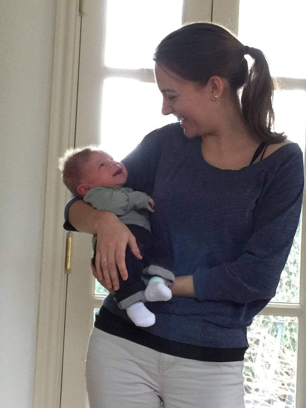 Nikki holding baby DC area postpartum support