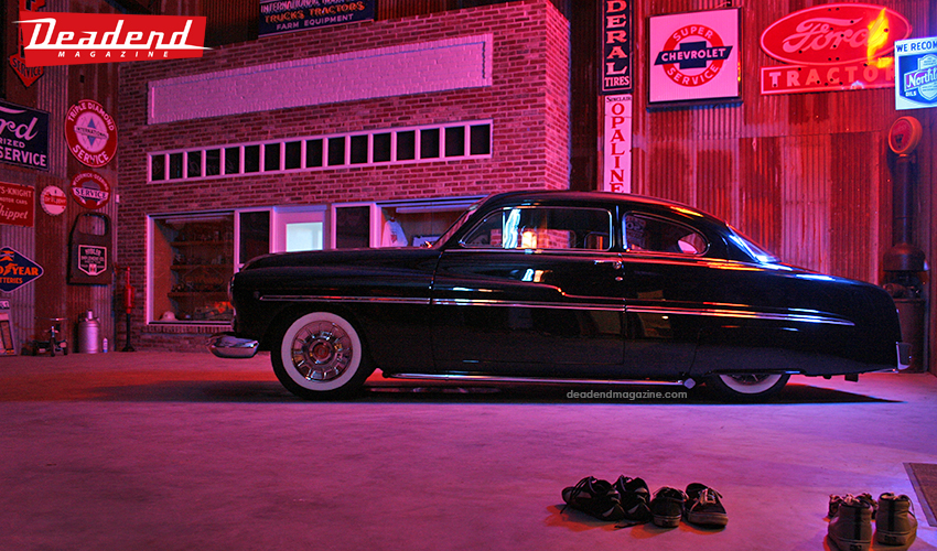 Flat Top Bob's Merc sitting pretty late night inside his warehouse.