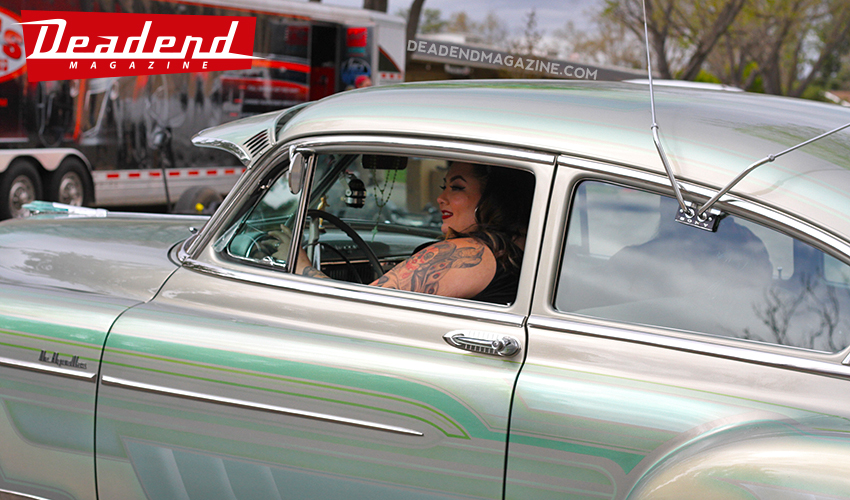 Ruby Ramirez cruisin' her custom painted Chevy bomb.