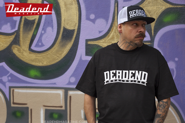 Abraham is wearing our Deadend Magazine Block Plaque Snapback mesh & t-shirt