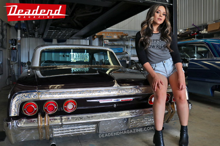 Sierra is seen here wearing the Deadend Magazine 'Support Your Local Low Rider' ladies' black & grey raglan.