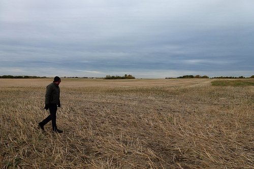 Inspecting the soil at our new farm in sturgeon county alberta