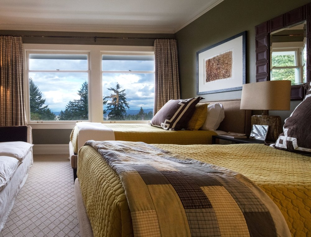 Twin bedroom with warm tones. Sophisticated interior design. Traditional home design. Daniel House.