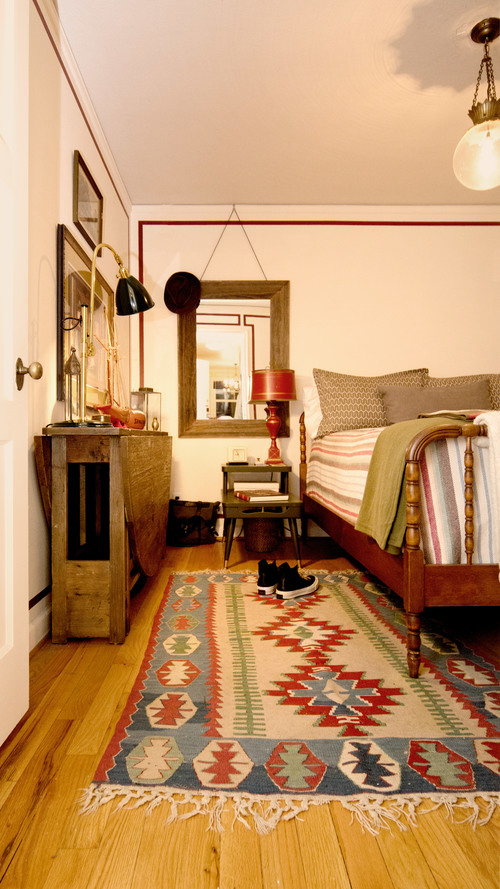 Tribal patterned rug. Comfortable bedroom. Classic design. Portland Apartment. Daniel House.
