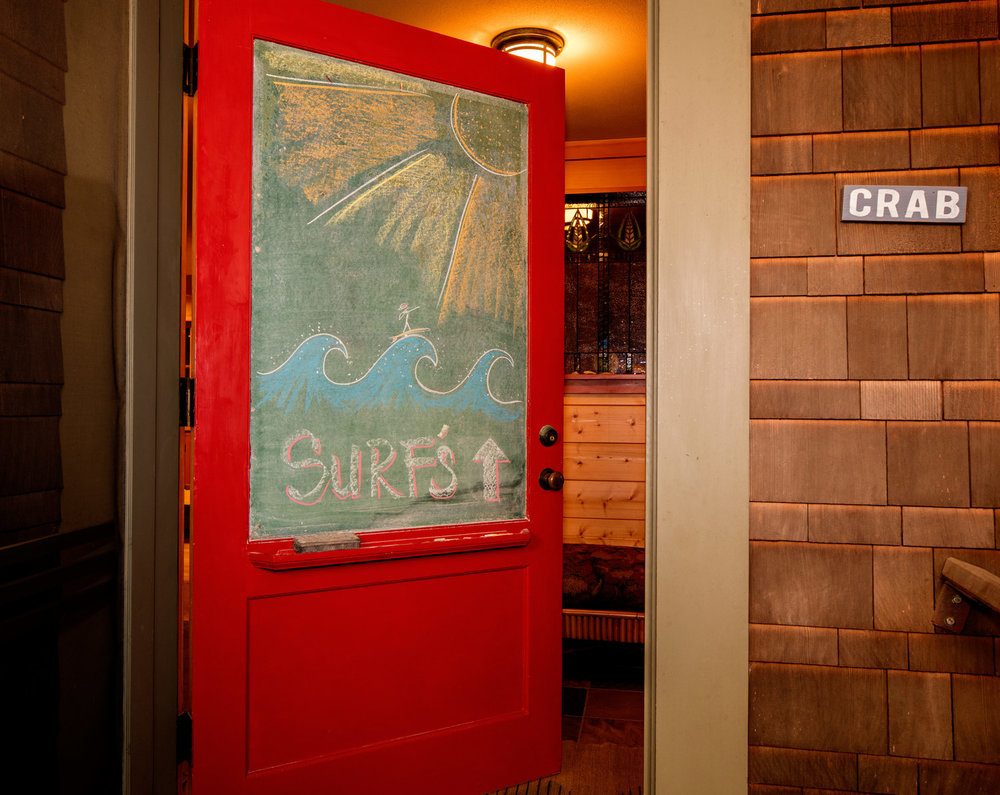 Front door of an Oregon beach house with built in chalk board. Cabin design, Cannon beach. Daniel House.