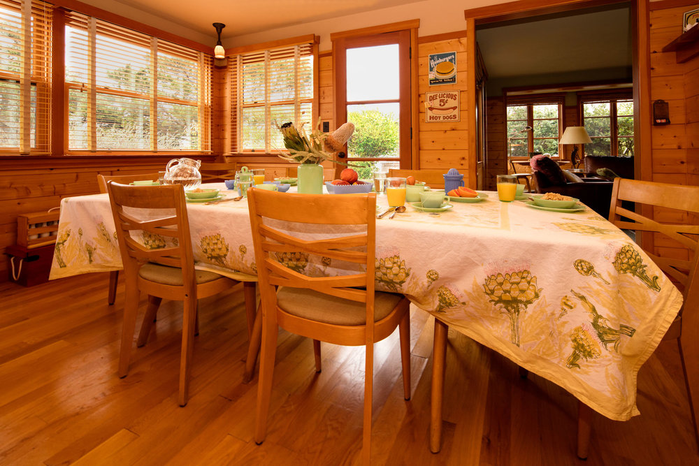 Traditional dining room in cannon beach cabin. Designed with pine walls and filled with 1940's antique furniture. Daniel House