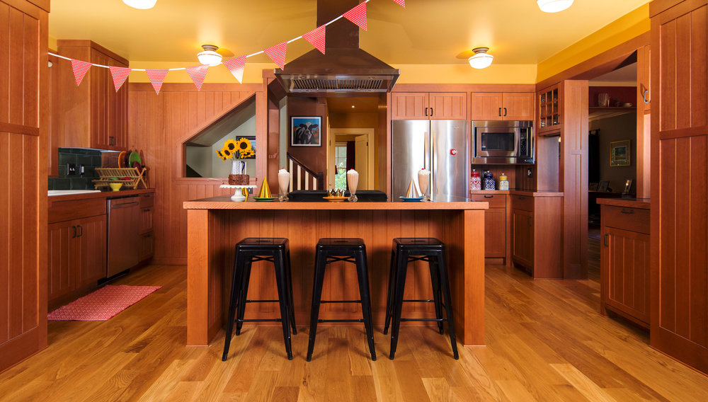 Kitchen island ready for party. Wood walls. Comfortable kitchen. Multnomah Village home. Classic design. Daniel House.