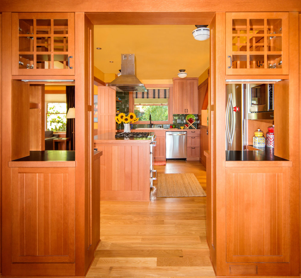 Wood kitchen with custom cabinets. Stove in island. traditional kitchen design. Portland Oregon kitchen. Daniel House.