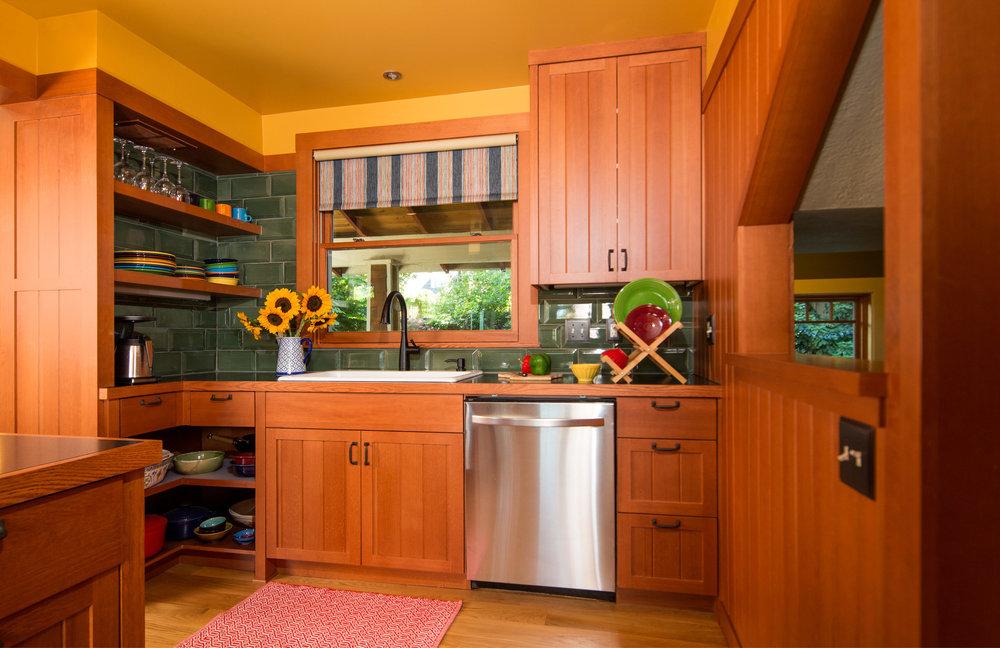 Classic kitchen design. Custom cabinets. Green tile backsplash. Portland Kitchen design. Daniel House.