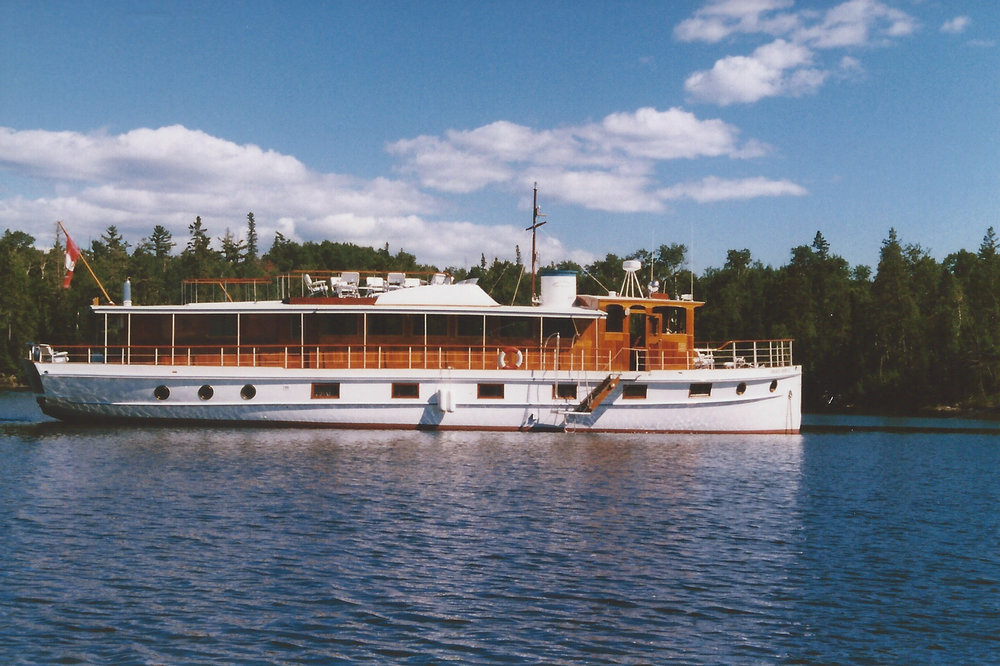 classic yacht used for fishing parties in Canada. Classic lifestyle. Daniel House