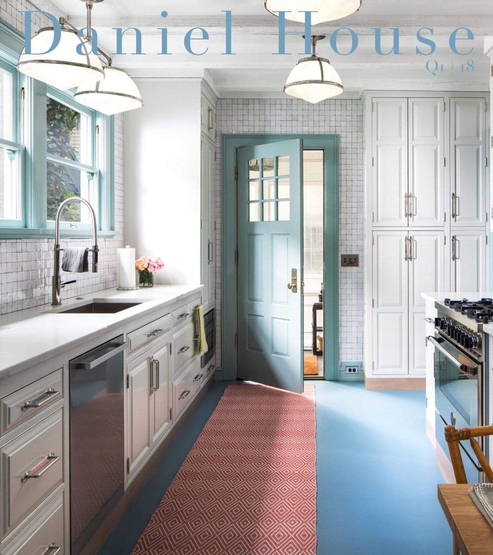 Daniel House Quarterly cover Q1 2018. Our latest kitchen design for a project in Portland. Its bright a cheerful. The white tile and paint lend a modern feeling. Still it remains traditional with colors used throughout and detailed woodwork on the cabinetry.