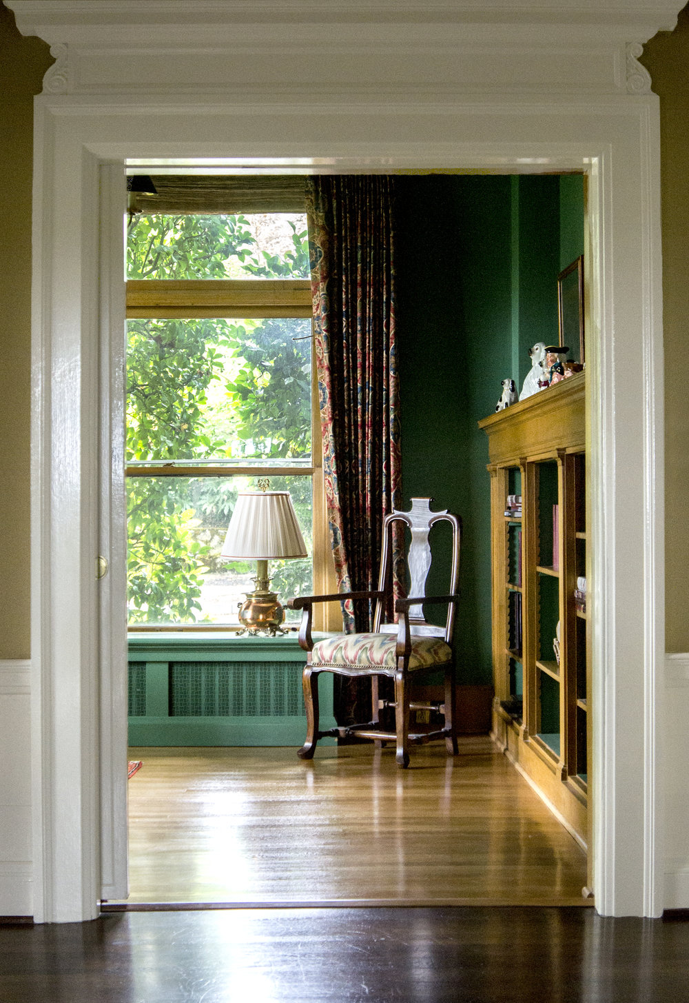 In the first colonial revival period, large ornamental doorways allow for spaces to flow seamlessly together.