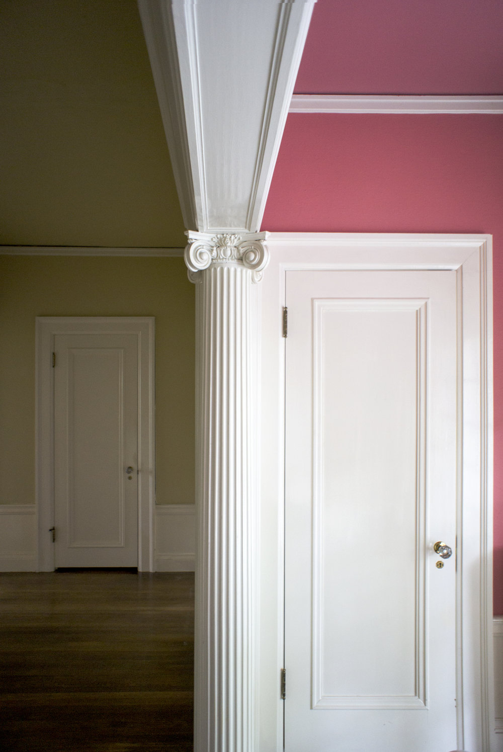 Ionic columns mark passageways throughout the interior of the house. This one separates the upper hall from a small sitting alcove.