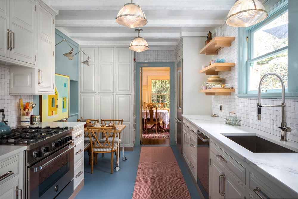 A previously dreary kitchen in Portland Heights was brought to life by adding bright lights and bright colors.
