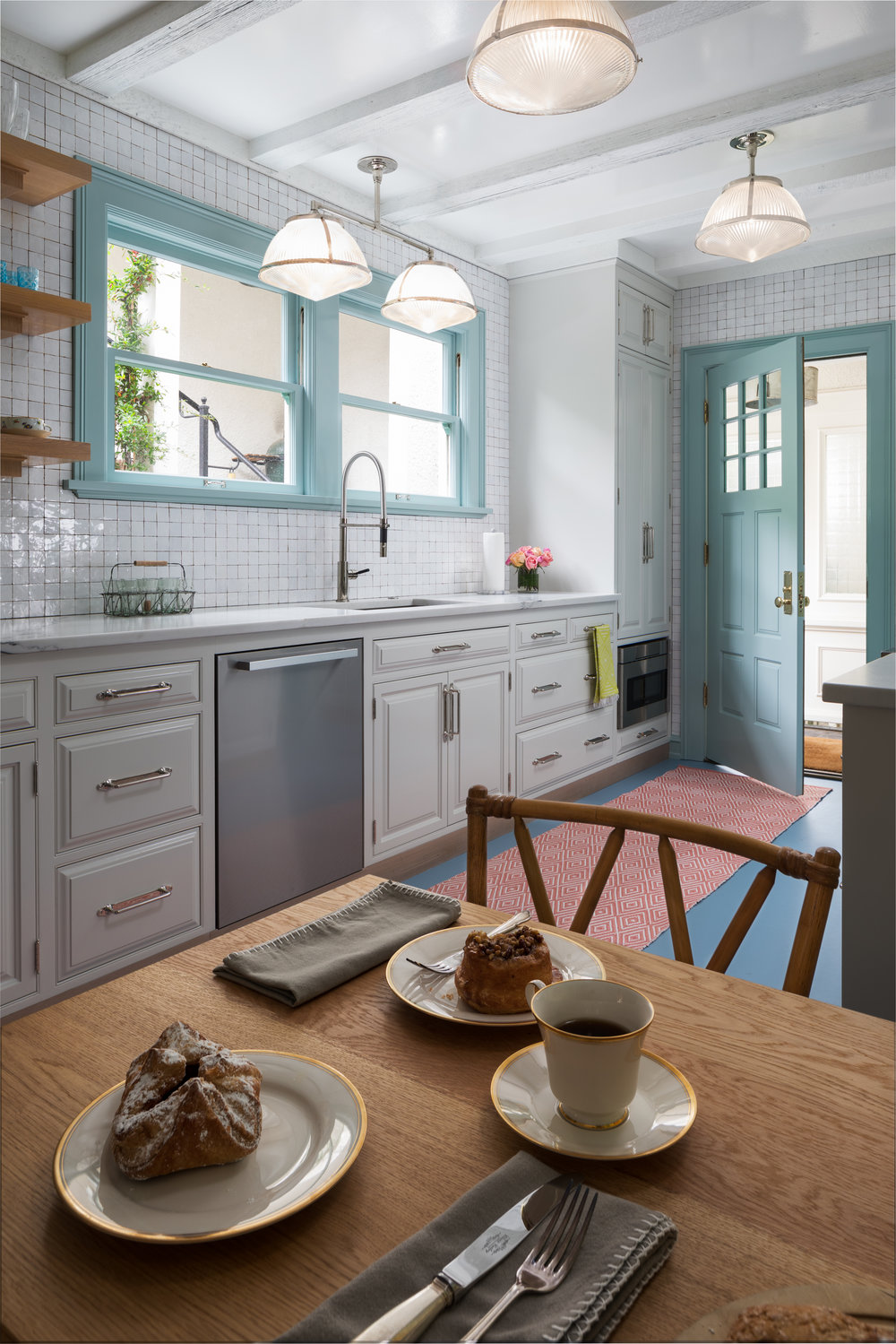 Portland doesn't have to be gray, this classic kitchen is bright and cheerful.