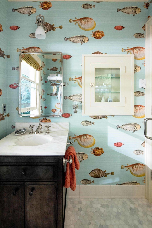 cheerful fish wallpaper makes this bathroom bright and fun